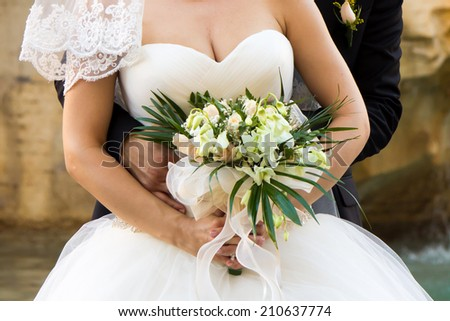 close up of the bride's bouquet during the wedding - stock photo