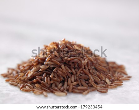 close up of the brown rice on marble table - stock photo