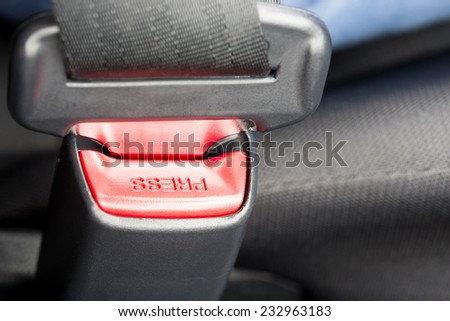 Close-up of the buckle of a seat belt or safety belt, vehicle safety device, concept of safe driving and transportation by car.