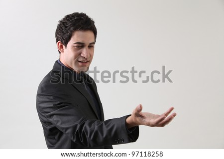 close up of the businessman looking at open hand - stock photo
