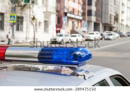 Close-up of the colorful lights on top of a russian police vehicle - stock photo