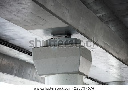 Close-up of the concrete support of an elevated road - stock photo