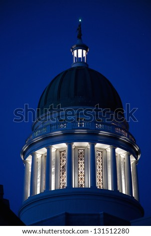 Close-up of the dome of the historic Maine State Capitol Building at night in Augusta, Maine - stock photo