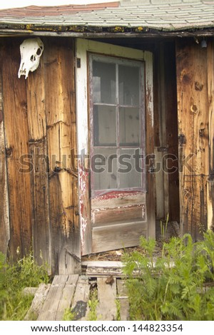Close-up of the door on a deserted old cabin in summer in Centennial Valley near Lakeview, MT - stock photo