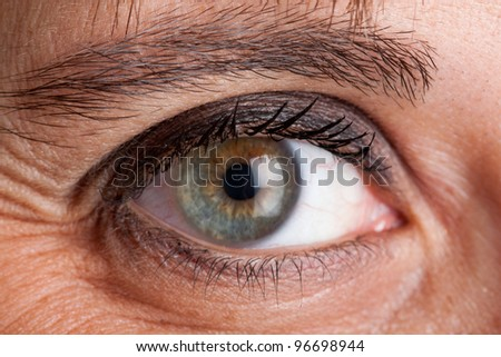 Close-up of the eye of a middle aged woman - stock photo
