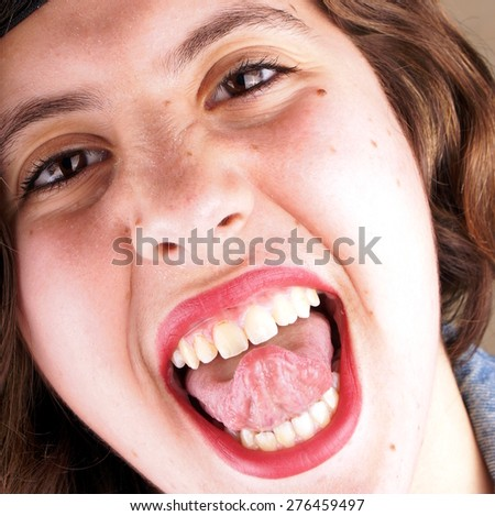 Close up of the face of a screaming young lady