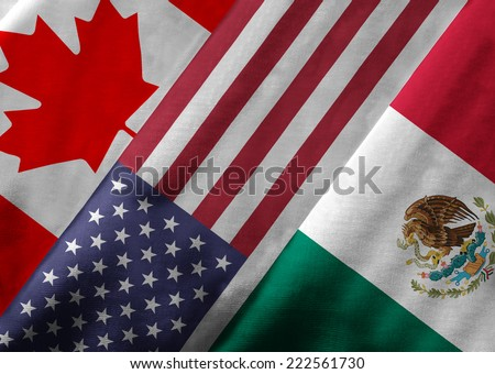 Close up of the flags of the North American Free Trade Agreement NAFTA members on textile texture. NAFTA is the world's largest trade bloc and member countries are Canada, United States and Mexico. - stock photo