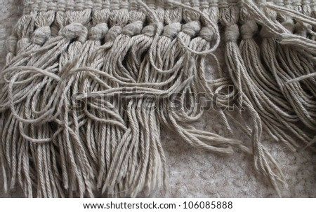 close up of the fringe of a rug, horizontally oriented / Living on the Fringe - stock photo