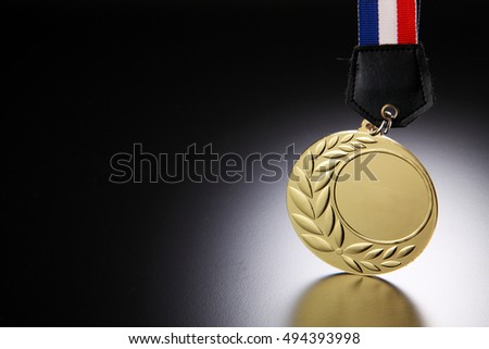 close up of the golden medal