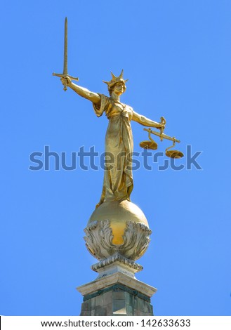 Close up of the golden statue on top of the Old Bailey the Central Criminal Court of England and Wales, a court in London and one of a number of buildings housing the Crown Court