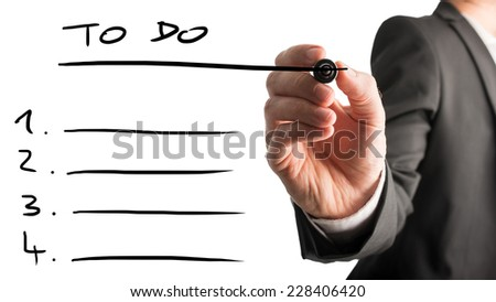 Close up of the hand of a businessman drawing up a to do list with a black marker on a white virtual interface with annotated numbers and blank lines for your text. - stock photo