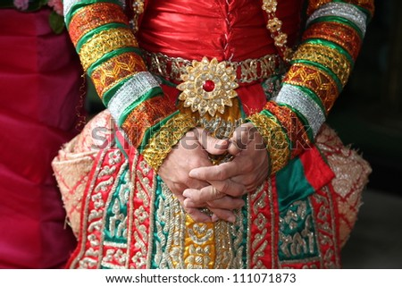 Close-up of the hands of a traditional Thai dancer.