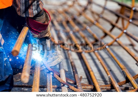 Close up of the hands welder worker with electrode. selective focus
