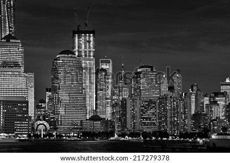 Close up of the illuminated buildings of New York skyline at night - stock photo