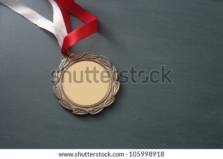 close up of the medal on the green board