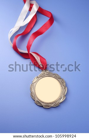 close up of the medal on the green board - stock photo