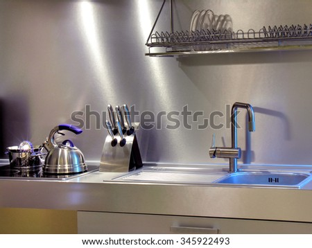 close-up of the modern kitchen equipment in the home interior in mixed lighting