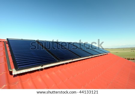 Close up of the new solar panels on red roof.