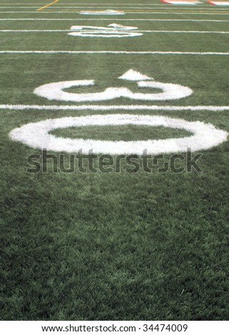 close-up of The number thirty on an american football field