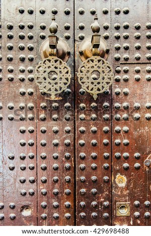 close-up of the old moroccan door with traditional pentagram on the door knock