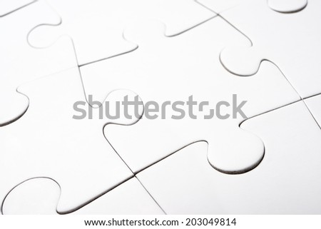 Close up of the pieces of a puzzle - stock photo