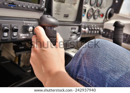 Close up of the pilot in the cockpit - stock photo