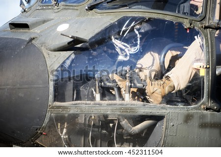 Close-up of the pilot's feet on the controls of the helicopter - stock photo