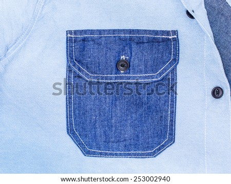 Close Up of the Pocket with Blue Striped Shirt - stock photo