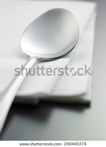 close up of the spoon on the napkin - stock photo