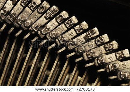 Close-up of the striking surface of old typewriter letter and symbol keys - stock photo