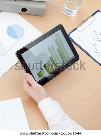 Close up of the tablet with diagrams and hand