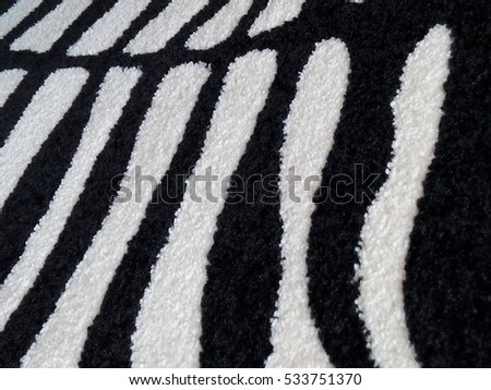 Close up of the texture of a black and white carpet