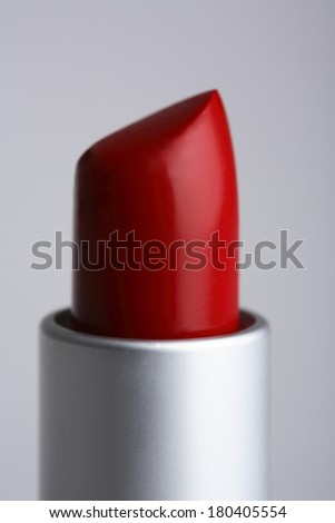 Close up of the tip of a red lipstick