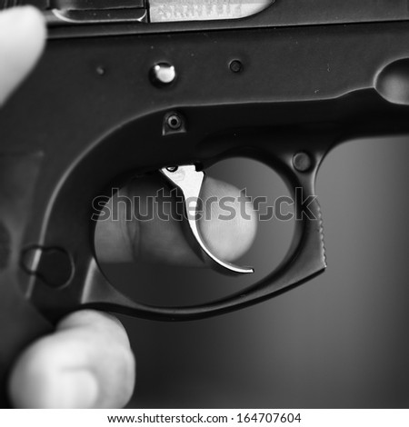 Close-up of the trigger of a rifle - stock photo