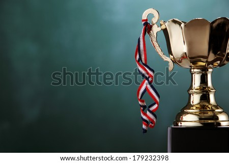 close up of the trophy in front of chalkboard - stock photo