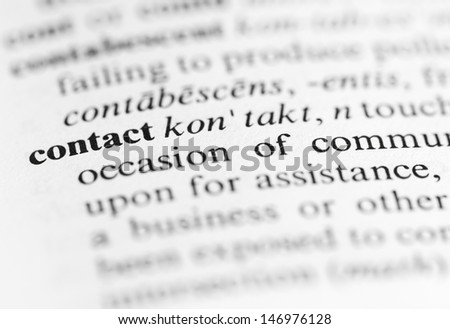 Close up of the word 'contact' and its definition in the dictionary