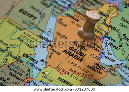 close up of the words Saudi Arabia on a world map marked with a push pin - stock photo