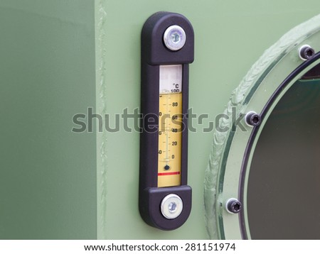 Close up of thermometer attached to the industrial equipment - stock photo