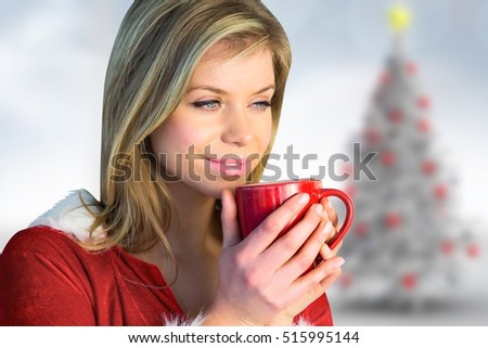 Close-up of thoughtful woman in santa costume holding a red coffee mug