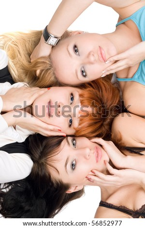 Close-up of three attractive women posing on white background - stock photo
