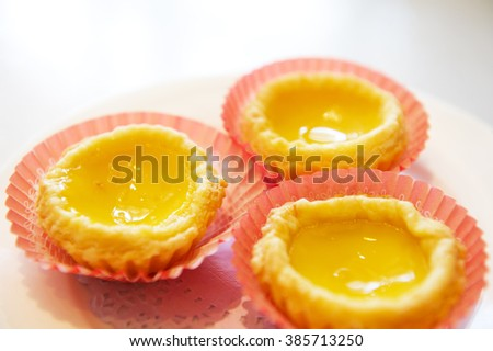 Close-up of three of egg tarts.