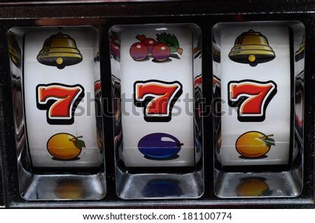 Close up of three seven jackpot on a casino slot machine - stock photo