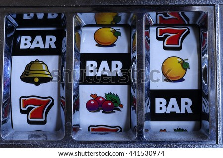 Close up of three seven Jackpot on slot machine - stock photo