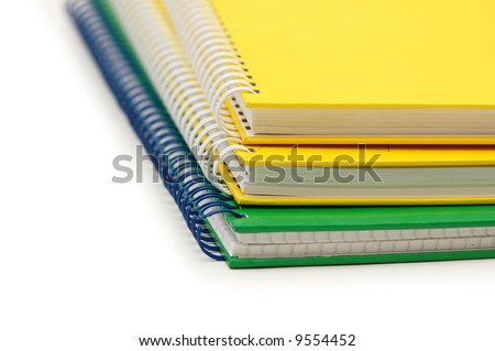 Close-up of three spiral books isolated on the white
