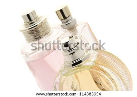 Close-up of three various female perfumes on white background. - stock photo