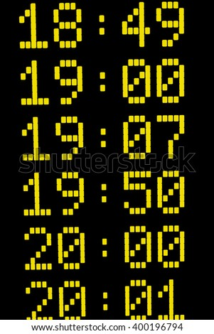 Close up of times on departure or arrival board for trains or other means of transport - stock photo