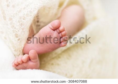 close-up of tiny baby feet - stock photo