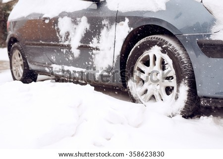 Close up of tire at snow. Winter. Shallow depth of field. - stock photo