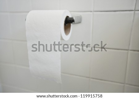Close-up of tissue paper roll in bathroom - stock photo