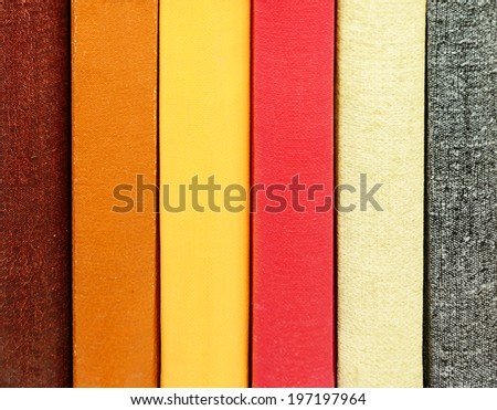 Close-up of title-less books in bookshelf - stock photo